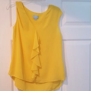 CeCe yellow ruffle top.